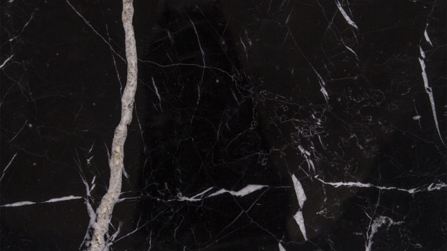 Alexandrette Black Marble is a kind of black marble quarried in Turkey. This stone is especially good for Exterior - Interior wall and floor applications, monuments, countertops, mosaic, fountains, pool and wall capping, stairs, window sills and other design projects. It also called Alexandra Black Marble,Hatay Black Marble,Bruno Perla Black Marble,Diva Black Marble,Black Queen Marble . Alexandrette Black Marble can be processed into Polished, Sawn Cut, Sanded, Rockfaced, Sandblasted, Tumbled and so on.