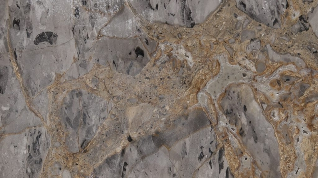 Golden Dragon Marble is grey base and black spots with golden streaks quarried from Turkey. This glamorous stone is especially used for indoor-outdoor wall and floor applications,hallway,kitchen countertops,and other design projects. This stone also called Grey Gold Marble,Dragon Marble,Afyon Dragon,Turkish Golden Dragon Marble . Golden Dragon Marble can be processed into Polished, Honed, Sawn Cut, Sanded, Rockfaced, Sandblasted, Tumbled